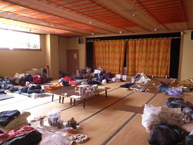 Volunteers sleep in the main dining hall